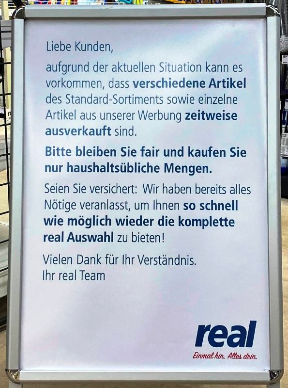 KOPP_Report_Hinweisschild_Supermarkt_Real