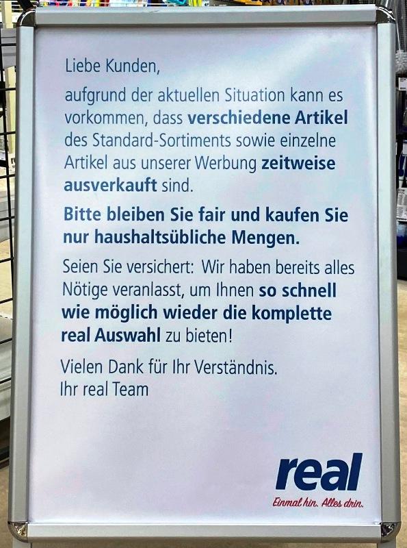 KOPP_Report_Hinweisschild_Supermarkt_Real
