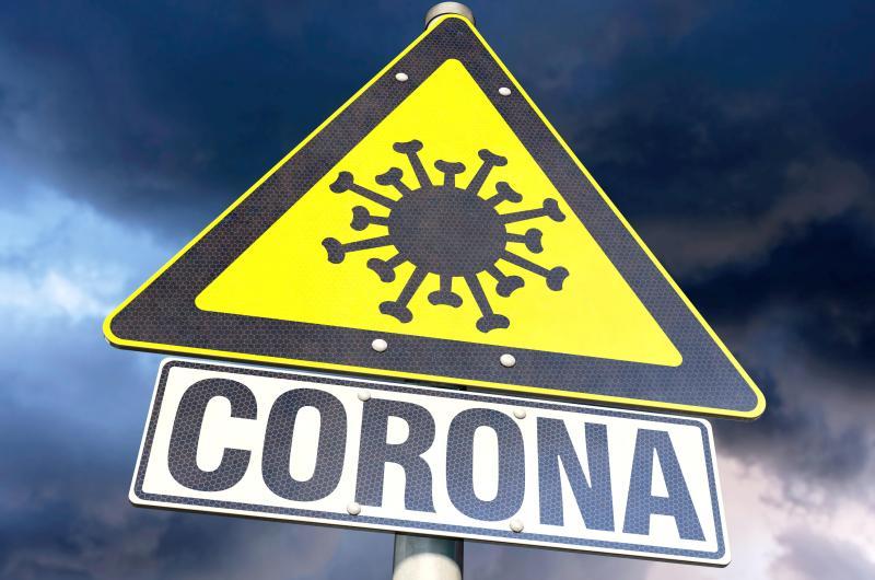 dpa222867725_corona_hotspod_warnschild